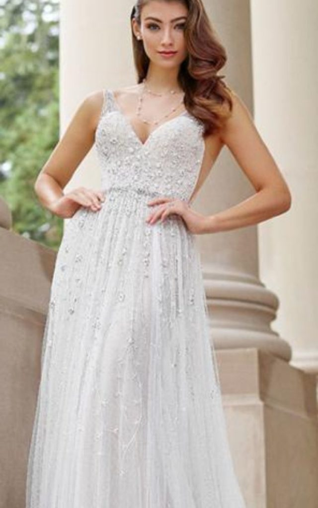 A-line wedding gown, with beading and embroidery in floral vine. This dress has narrow lace illusion straps and illusion side panels. Bridal shop Colorado Springs, Bridal Elegance
