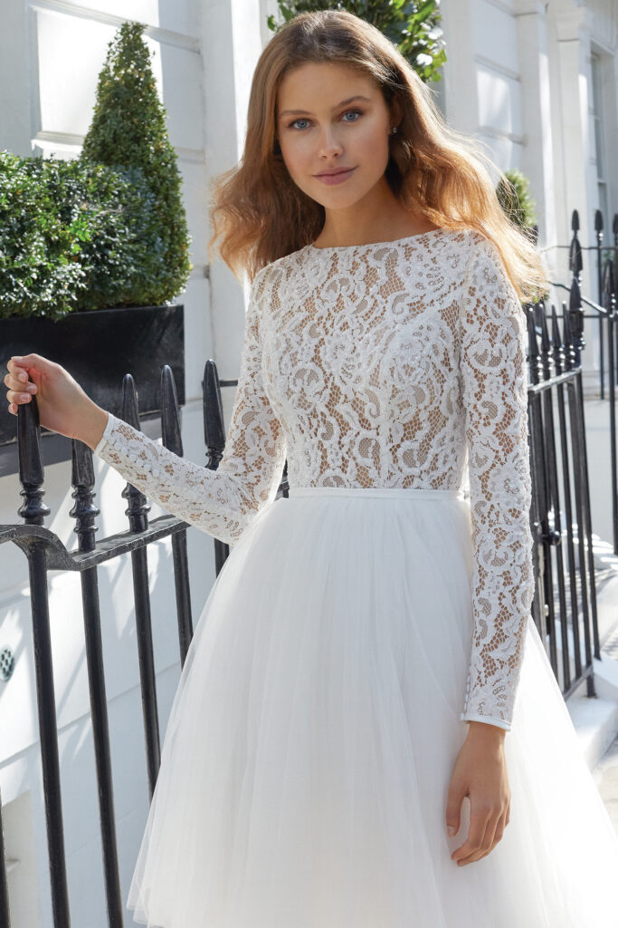 Long Sleeve Knee Length Wedding Dress with Beaded Lace and Tulle Skirt. Bridal store in Colorado Springs, CO Bridal Elegance