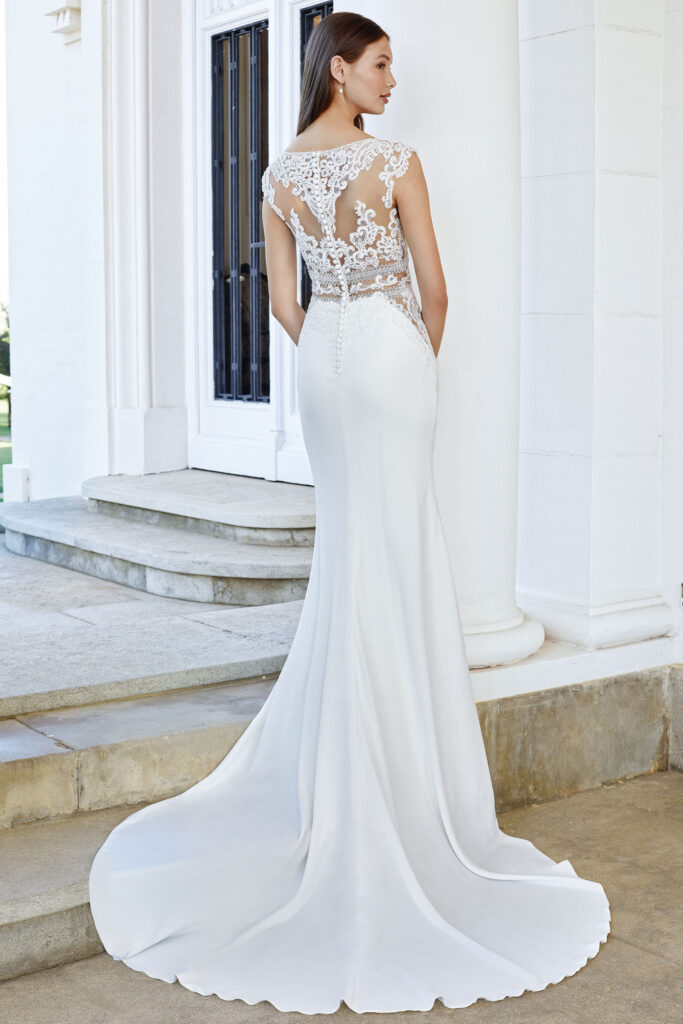 Crepe Fit and Flare Wedding Gown with Waist Cutouts and Beaded Lace. Bridal store in Colorado Springs, CO Bridal Elegance