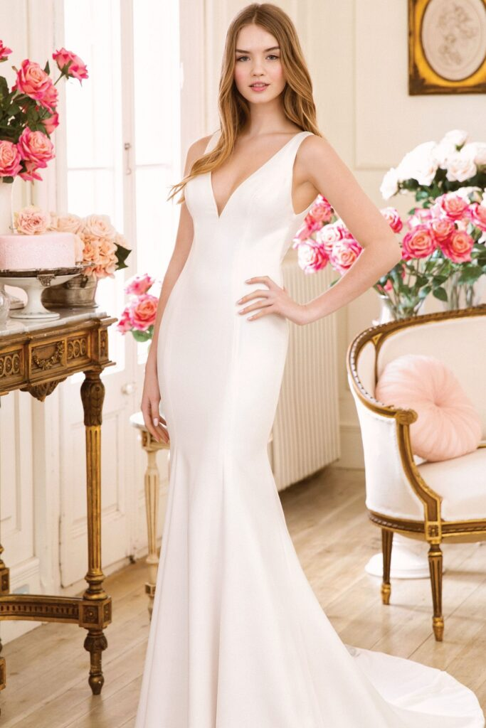 Crepe Fit and Flare Wedding Gown with Plunging V-Neck. Bridal store in Colorado Springs, CO Bridal Elegance