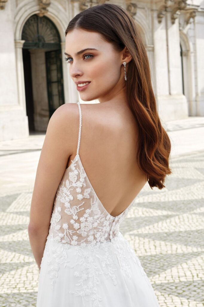 Illusion Bodice A-Line wedding dress with plunging V-Neck. Bridal store in Colorado Springs, CO Bridal Elegance