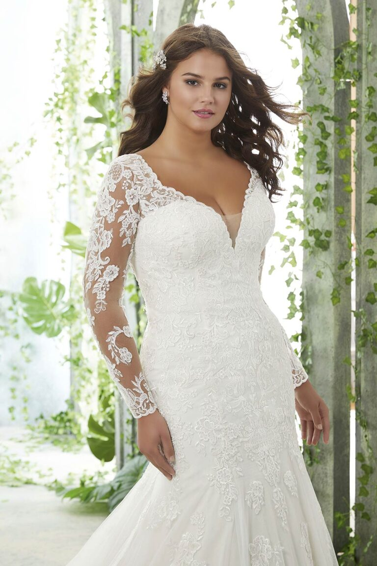 Frosted, Alençon Lace Appliqués on a Tulle, Fit and Flare Gown with Wide Scalloped Hemline and Long Sleeves. Bridal store in Colorado Springs, Colorado Bridal Elegance