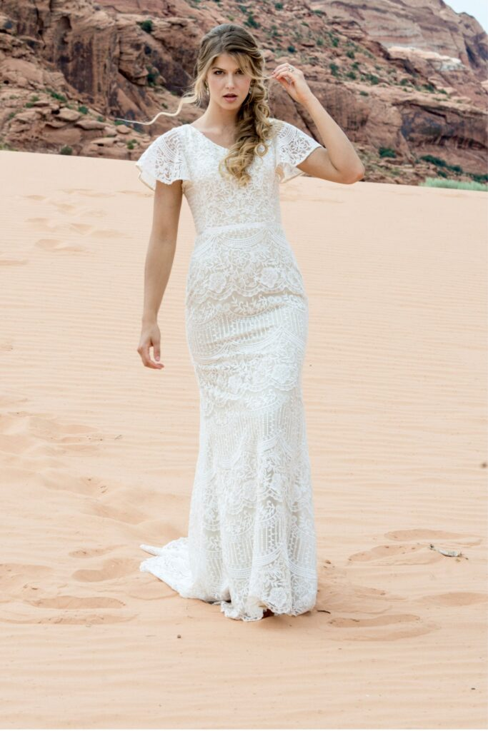 A-line bridal gown, allover lace with sequin over tulle. This features short lace flutter sleeves with modest cap lining, and removable satin ribbon at waist. Bridal store in Colorado Springs, Colorado, Bridal Elegance